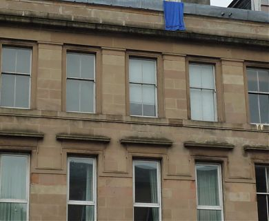 Towel hanging from top flat at 527 Great Western Road, Glasgow.