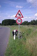 bike, leaned against traffic sign