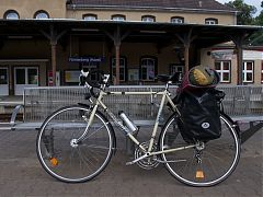Bianchi bike with full panniers, leaned against bench at Fürstenberg Havel train station